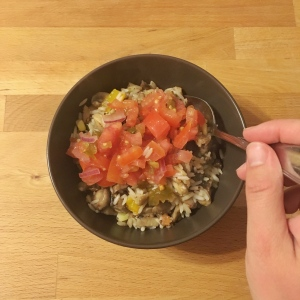 dinner made with leftover rice, mushrooms, onion, and tomatoes