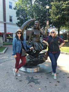 posed photo with a friend and a statue of samantha from bewitched